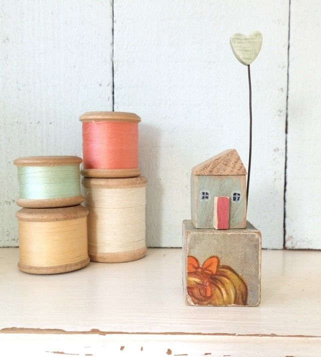 Little wooden house with clay heart on a vintage toy block