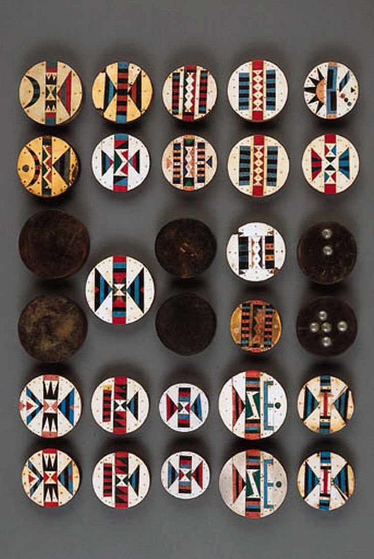 Africa | 29 earplugs ~ amashaza ~ from the Zulu people of South Africa | Five pairs of amashaza plugs inlaid with geometric vinyl designs; thirteen single amashaza plugs similar to the preceding; two pairs of plain wood plugs; and another pair with inset metal upholstery nails | 2,990$  ~ sold (Nov '07)