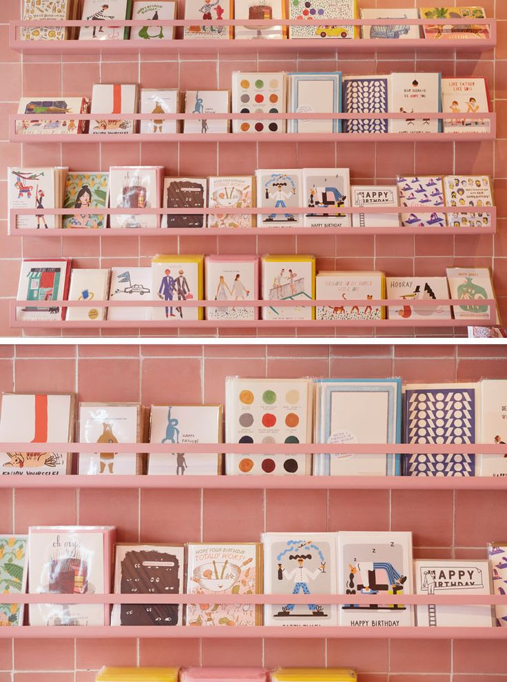 In this modern retail store, this greeting card display is colored the same as the dusty pink tiles, almost blending into the walls.