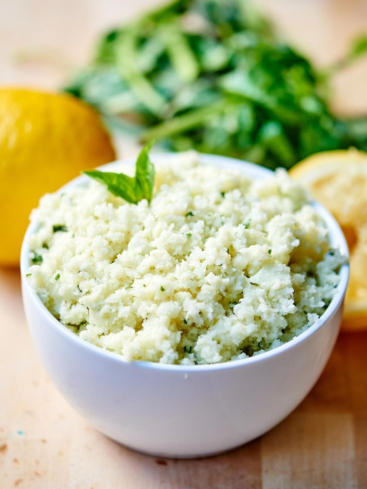Lemon Garlic Cauliflower Rice. A healthy substitute for rice! It's naturally gluten free, vegetarian (can be vegan!), and so tasty! Full of fresh lemon juice, basil, garlic, and parmesan cheese. Less than 300 calories for the WHOLE recipe! showmetheyummy.com
