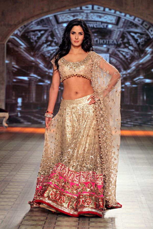 Manish Malhotra gold and cream lehenga