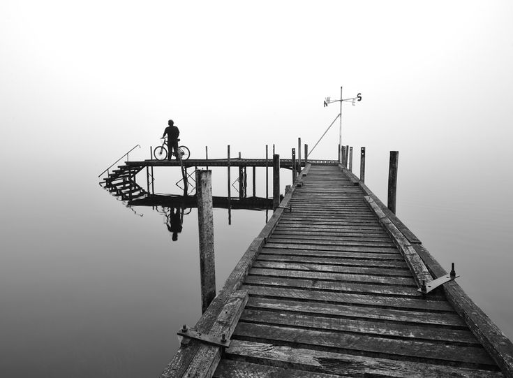 """SECLUDED PIER AT LAKE BRUNNER (Places) - I was on my 170 km solo cycling trip around West Coast, New Zealand and one of the destinations was famous Lake Brunner. I reached this pier one foggy morning and I found this moment was """"like no other"""". (Photo and caption by Mohd Nadly Aizat Mohd /National Geographic Photo Contest)#"""