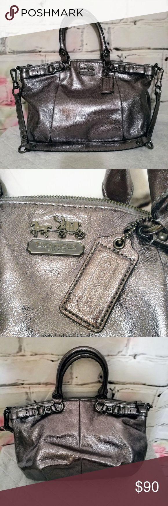 """🆕♥️Coach Madison Metallic Silver Satchel Coach Madison Metallic Leather Sophia Satchel (authentic) - foiled metallic silver leather, interior lined with beautiful cobal blue  - accented with buckles on front and back - strap is detachable - bag in great shape. Some very slight standard wear (barely noticeable) on inside at zipper. See last pic.  - Inside serial number H1173-18816 - Approx measurements: 14""""L x 10""""H x 3""""D -Strap Drop: 5"""" for handles and 10"""" detachable strap Coach Bags…"""
