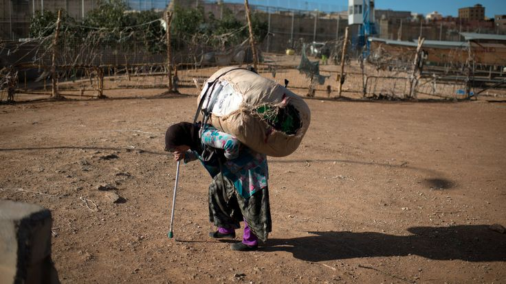 Women known as 'mule ladies' carry large bundles on their back, earning as little as three euros per trip, on the Moroccan-Spanish border.  Many of these women are grandmothers and some are in their sixties.