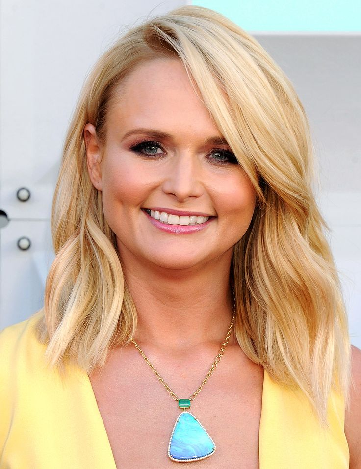 Love these loose waves- MIRANDA LAMBERT