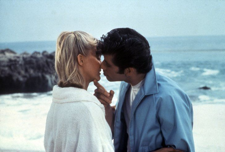 Pin for Later: The Most Memorable Movie Beach Scenes Grease It's summer lovin' for Danny (John Travolta) and Sandy (Olivia Newton-John) before they unexpectedly run into each other at school.