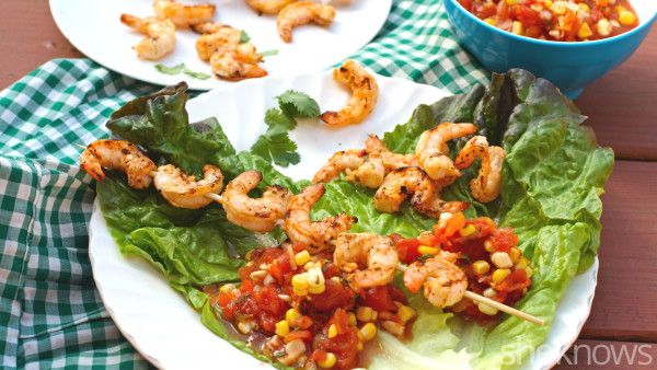 Turn spicy shrimp kebabs into flavorful lettuce wraps topped with corn salsa