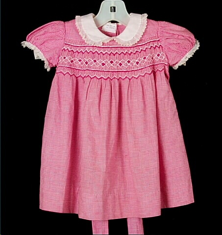Children's fashion from the 1920s -  toddlers often wore smocked dresses with a yoke at the neck.