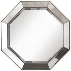 """Octagon Mirror  NOW $149.99     Generously sized and edged in gold tones, this mirror could be the final, classic detail that pulls a room together or that adds a touch of glamor to entryways.       Antiqued Gold/Antiqued Silver  32""""W x 2""""D x 32""""H  Mirror and manufactured wood   NC lacquered finish  Exclusively Pier 1 Imports"""