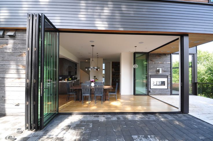 Bifold doors, first floor cladding and soffits