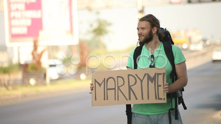 hitchhiking young adult man displaying marry me proposal sign board - Stock Footage | by ionescu #hitchhiker #marryme #proposal #stockfootage #pond5