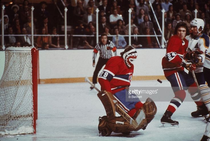 Canadian professional ice hockey player and later businessman, lawyer, author, and politician Ken Dryden, goalie of the Montreal Canadiens, makes a save as teammate Don Awrey #24 defends against an opponent during a game against the Buffalo Sabres, Buffalo, New York, 1970s. Dryden played for Montreal from 1970 to 1979. He was elected to the Parliament of Canada as a Liberal in 2004 and named to the Cabinet of Paul Martin.