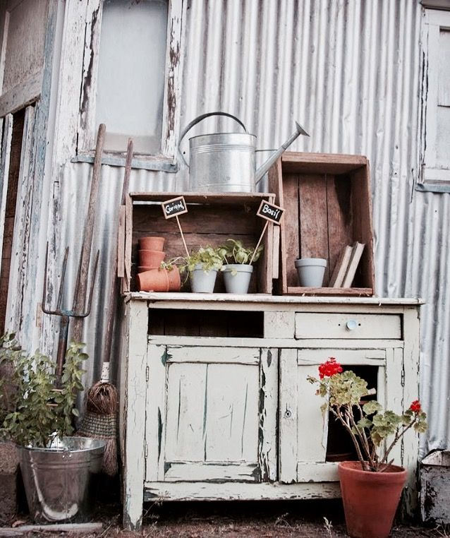 Potting stand, made from an old dresser and fruit boxes