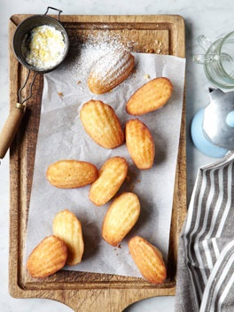 "Madeleines.  Dusted with powdered or lemon sugar.  I'm going to go ahead and call an exception to the ""don't buy a kitchen item that can only make one thing"" rule."