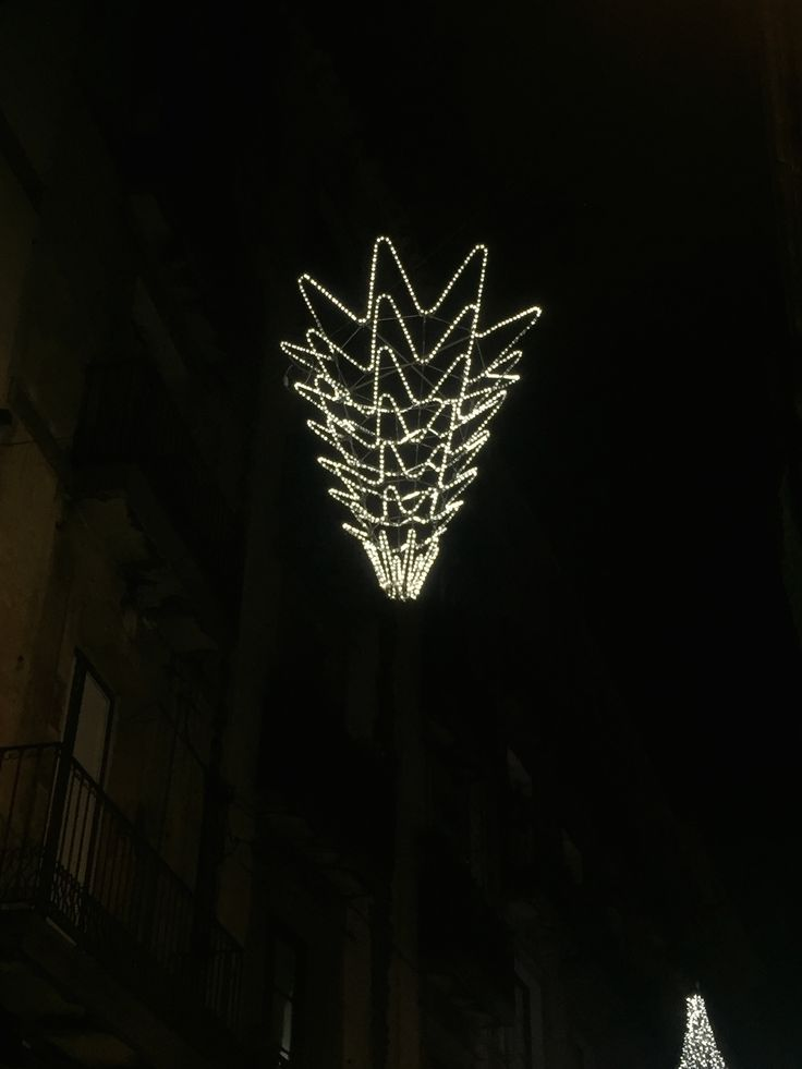 This christmas decoration was found on Carrer dels Boters in the gothic quarter. It depicts an upside-down Christmas tree that has white lights which create a curved outline of it.