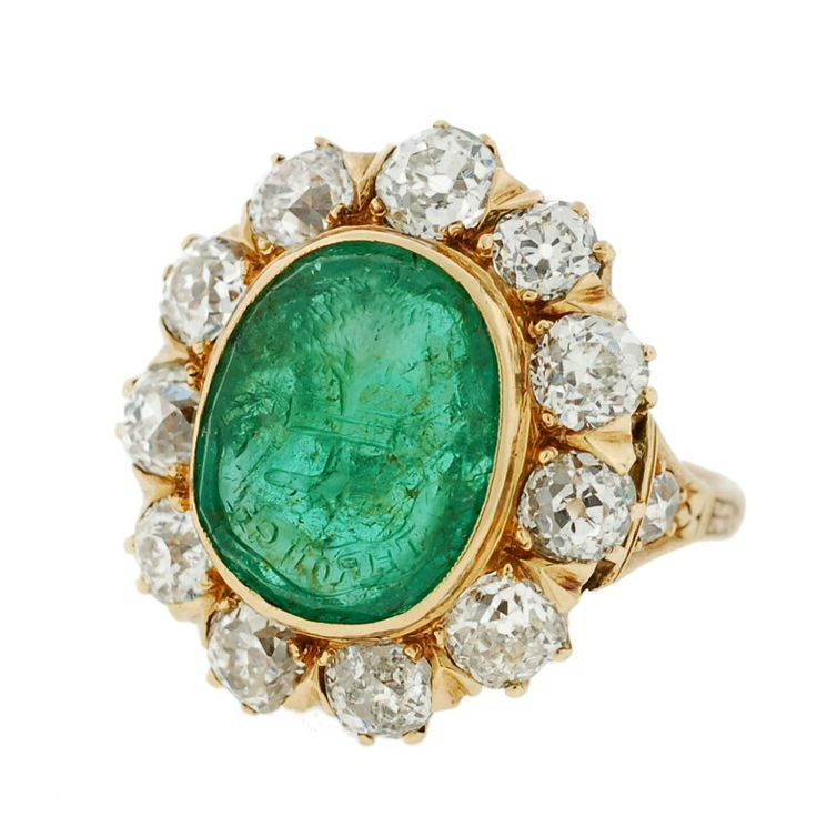emerald with an intaglio carved into the center the image