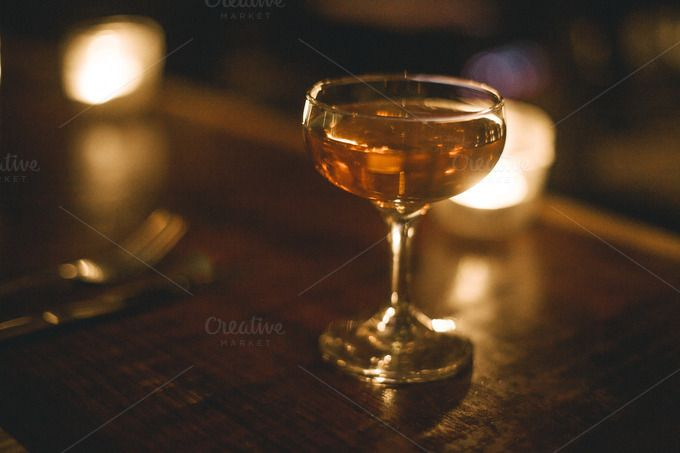Cocktail in coupe glass by Sean Berrigan Photography on Creative Market #cocktail #bourbon #liquor #candles #bar #fall #gold