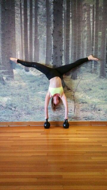 Aiming for the splits in a handstand