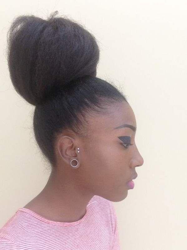 high bun hairstyle. Her bun is amazing !