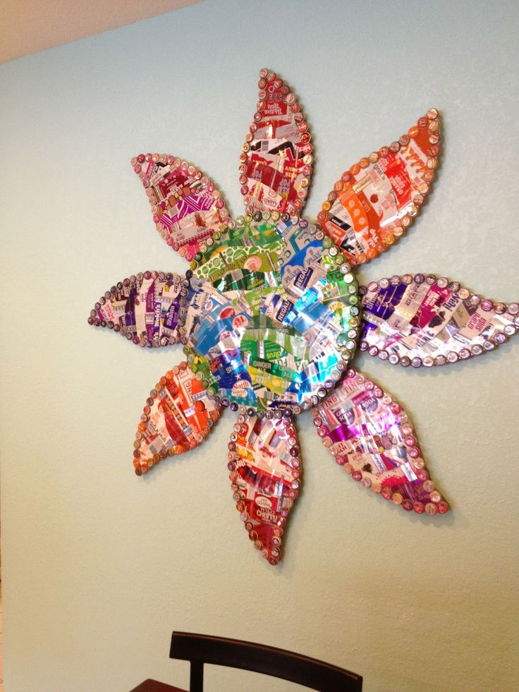 SOLD More art from THE Hot Florida Sun, Mexican Sea PROJECT...   The Moore Family Folk Art Rainbow Earth Art Flower by Folk Artist Alan Moore.  Vintage (a few modern) bottle caps and vintage steel soda cans. SOLD