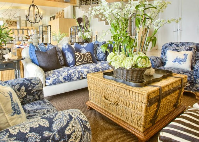 I can see my sisters and I chatting here.    blue and white, wicker trunk coffee table