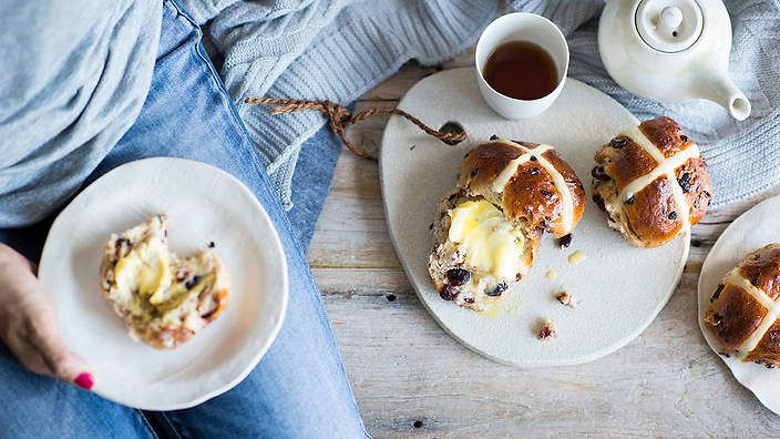An updated version of the traditional favourite, @annekamanning's hot cross buns are studded with chunks of dark chocolate and tart, dried cherries.