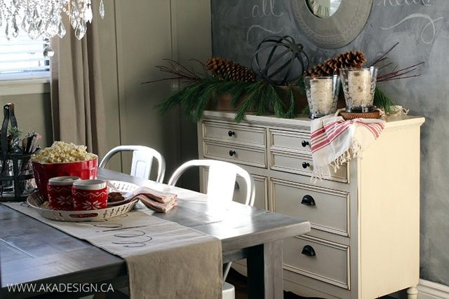 Chalkboard feature wall, creamy white sideboard, glass chandelier, Tolix chairs and grey table - such a fun mix!