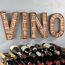 Love this wine sign made of corks...A custom wooden wine rack would look great…