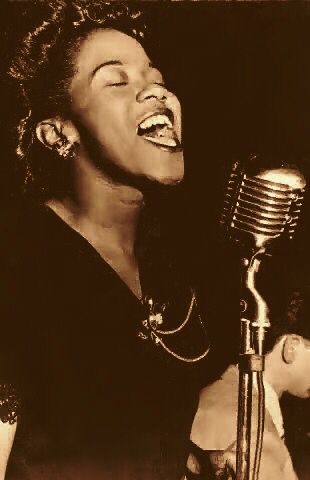 Young ELLA FITZGERALD.                                                                                                                                                     More