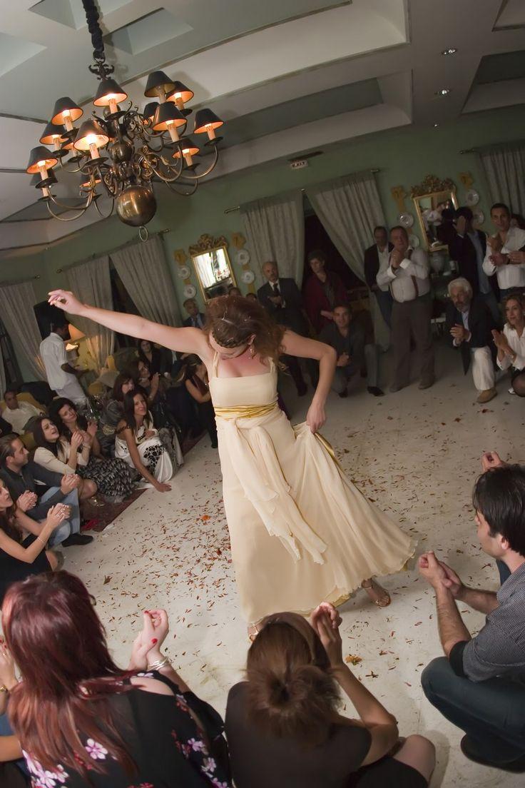 Bride dancing traditional Greek song Wedding La Maltese venue Santorini