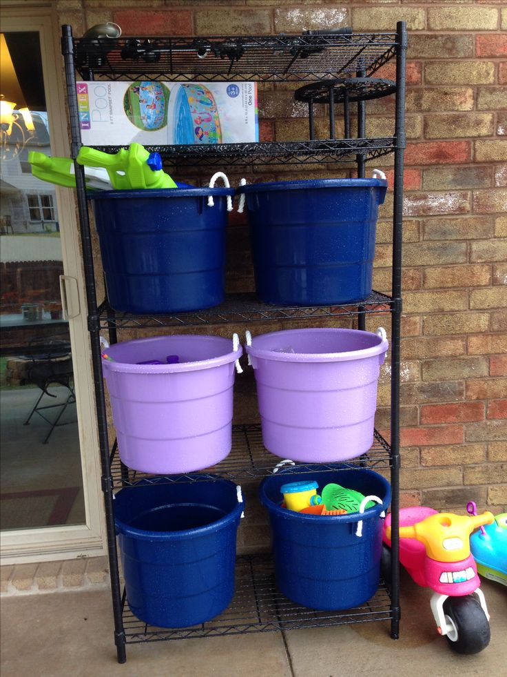 Backyard outdoor toy storage. Great for water guns, bubbles, chalk, sand toys, etc.