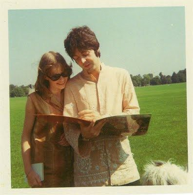 Candid photo of Paul signing Pepper LP for fan in park, as ...