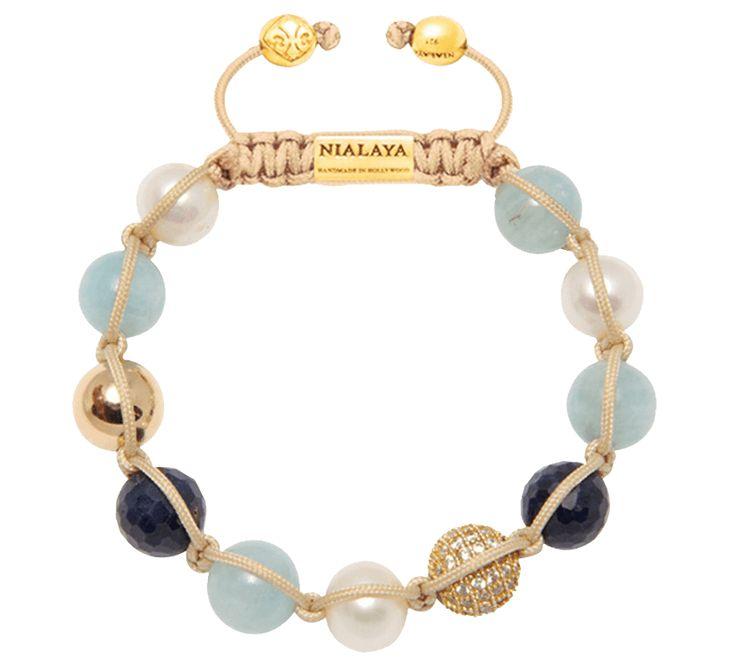 Необыкновенное сочетание цвета в женском браслете из натуральных камней добавит нежные нотки в ваш повседневный или праздничный образ. Дизайнерское украшение сочетает аквамарин, сапфир и жемчуг. Цветовая гамма аксессуара напоминает морские приключения. Купить браслет — запечатлеть воспоминания о прекрасном.