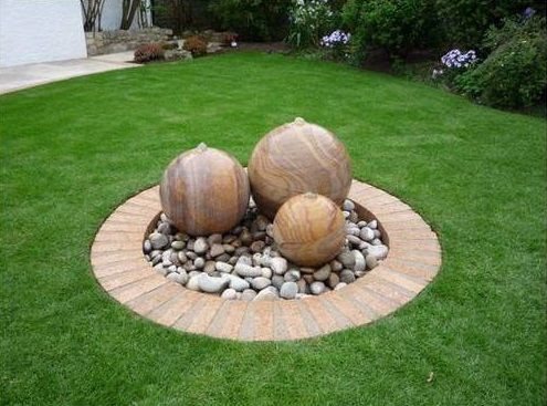 #Beautiful #rainbow #sandstone #balls decorated with #sandstonespebbles and #stonecircles for your #garden. Buy these #beautifulsandstone products by the #landscapingcompanyinIndia, #StoneMartIndia. https://goo.gl/cWxrSv