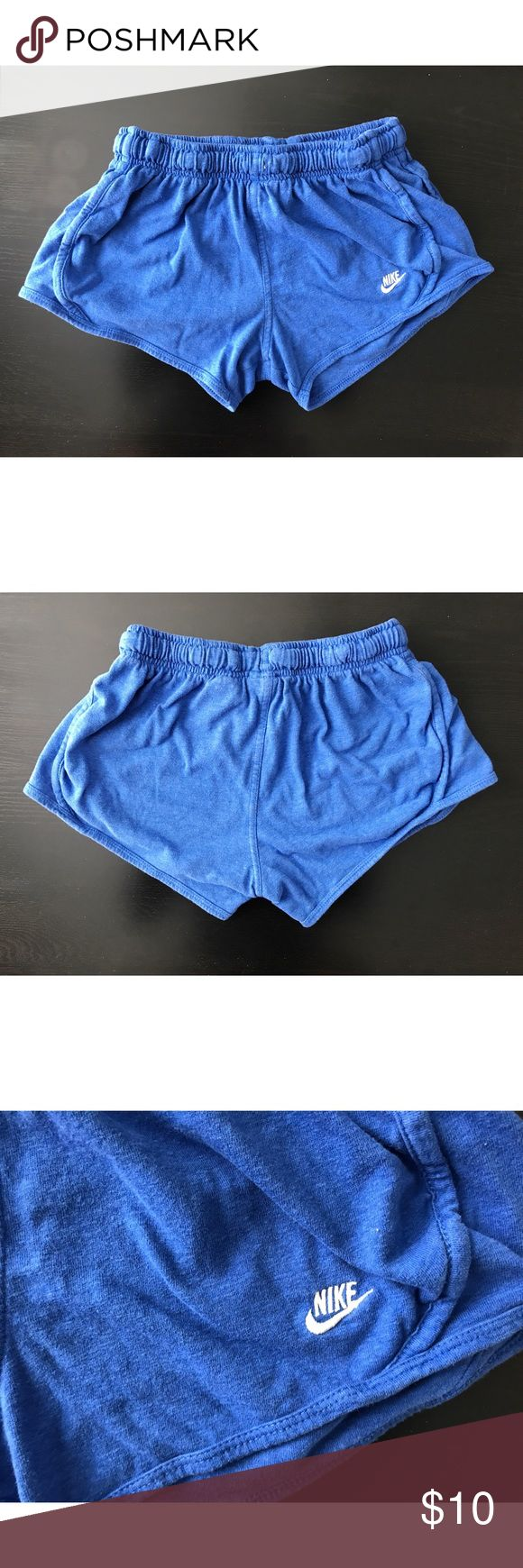 Nike cotton shorts Only worn a few times. Royal blue and bought at a Nike store. They are cotton and a XS Nike Shorts