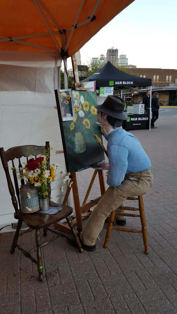 "Scarecrow Contest at the City Market. This was mine. Norman Rockwell painting on one of my unfinished ""Summer Sunflowers"" 24x30 Gallerywrap acrylic paintings. The still-life flowers were bought from one of the local venders."