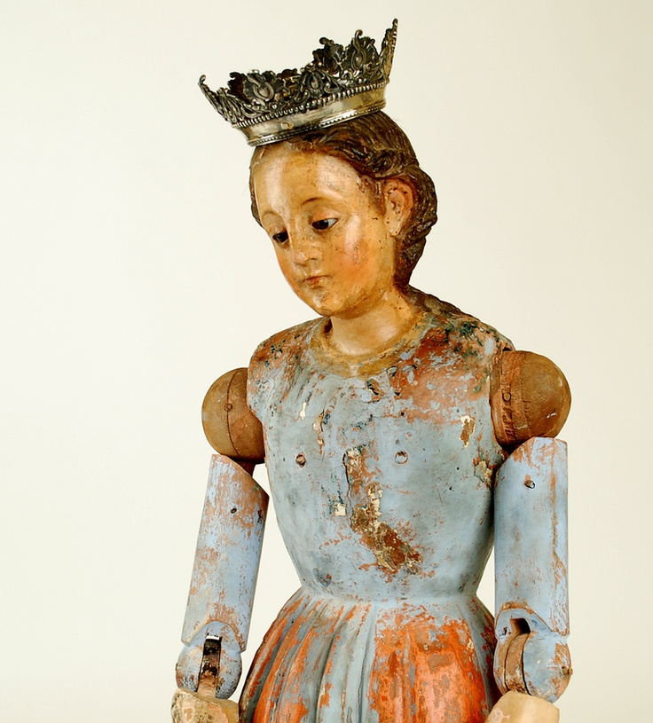 18th century Spanish colonial Madonna - carved from a single timber with inset glass eyes, articulated arms; jointed both at the shoulder and elbow. Fitted with a Spanish colonial silver crown.