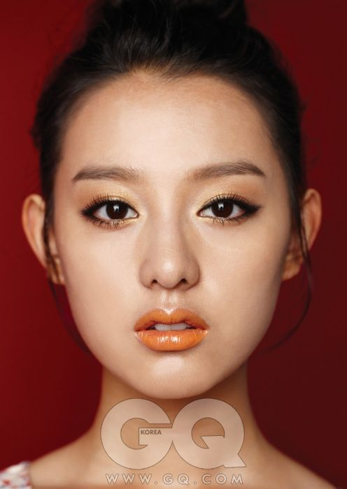 Beautiful Chinese make up - golden eyes and orange glossy lips
