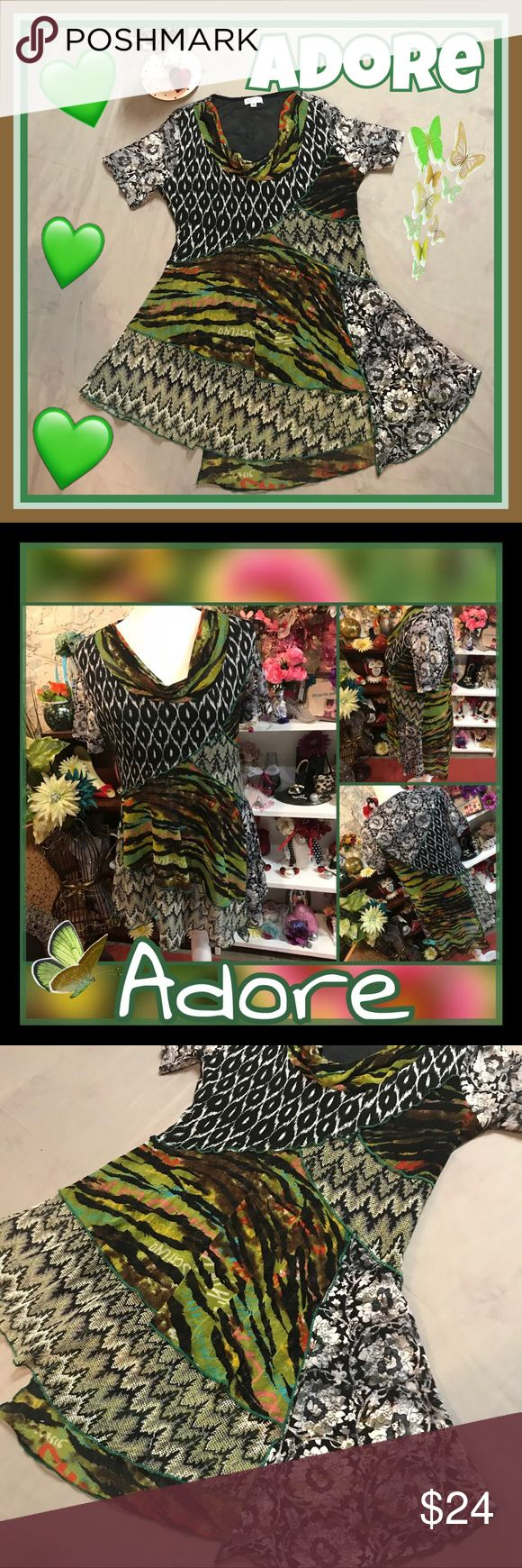 Adore A-Symmetrical Tunic-Dress Truly unique Asymmetrical cut ..multi patterned...tunic to wear with leggings or short dress. In excellent used condition.. no holes or stains. Just a few minute loose strings here and there😊 ..Please see all pictures.. Posted a lot of pics to show uniqueness of cut and beauty of this top/dress. 18 inch bust .,30 inch length at shortest point.. 32 inch length at longest point.. please also feel free to comment any questions. keep in mind preowned items are…