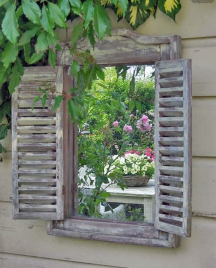 Love mirrors in the garden - SO DO I !! THIS ONE LOOKS SO BEAUTIFUL, ESPECIALLY WITH THE SHUTTERS EITHER SIDE!! - SO CLEVER & JUST GORGEOUS!!