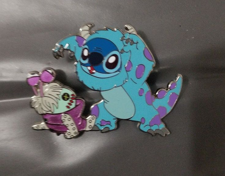 DISNEY stitch fantasy pin - $45.00. This pin features stitch as sulley and scrump as boo. This is a Disney fantasy pin and is not tradeable at Disney parks or with disney cast members. The pin pictured will be the pin you receive. 282862463049