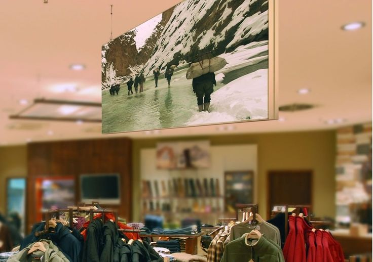 A ceiling-hung fabric frame banner in a retail shop.