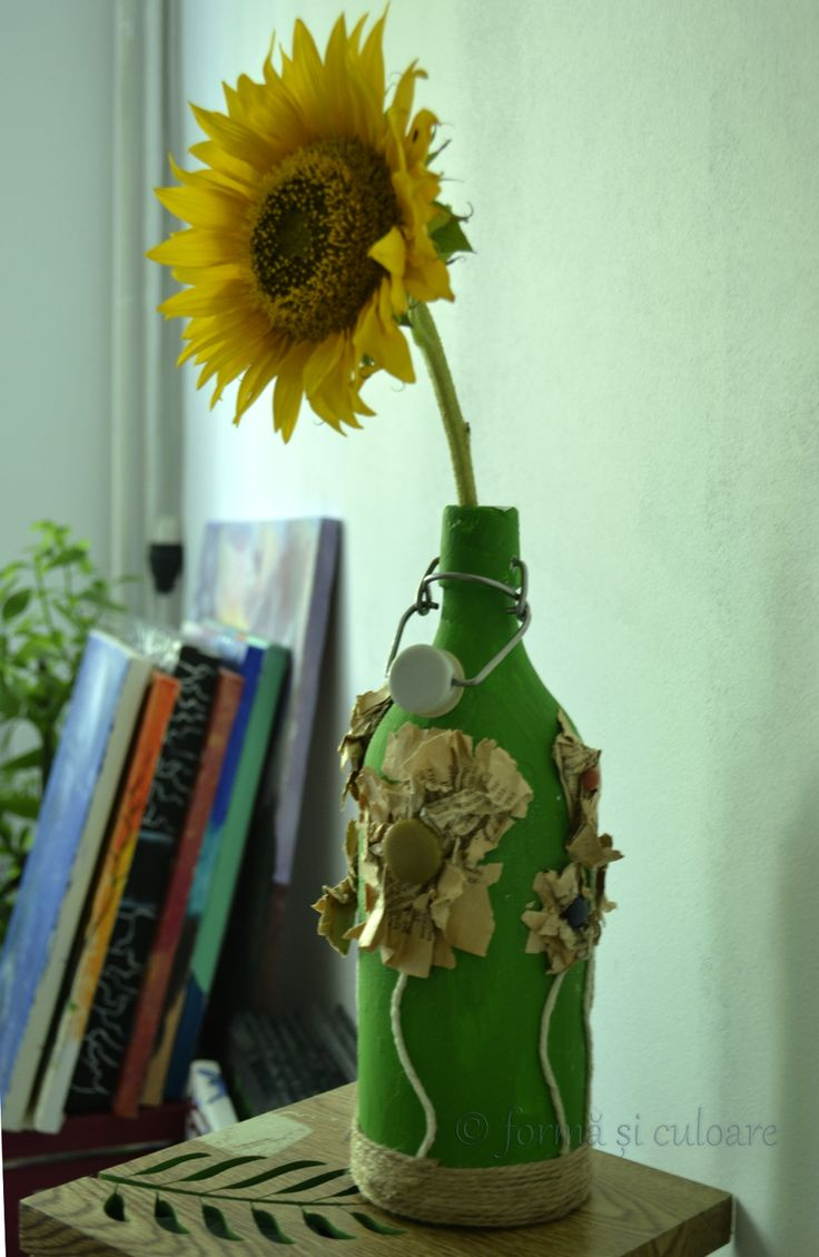 Any simple bottle can become a unique vase. Some time ago I bought from a fair some old books. I just love the smell of time through the old pages. Growing paper flowers on this painted bottle. http://formasiculoare.wordpress.com/2014/07/31/paper-flower-vase/