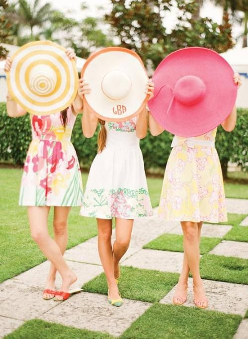 Floral print dresses paired with heels and big hats are perfect attire for a garden party!