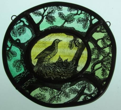 Thrush's Nest. Stained Glass by Tamsin Abbott. Tamsin studied medieval English at Stirling University where she became intrigued by the illustrations in the text. Further study and many years later, she creates the most beautiful stained glass from her studio in Herefordshire.