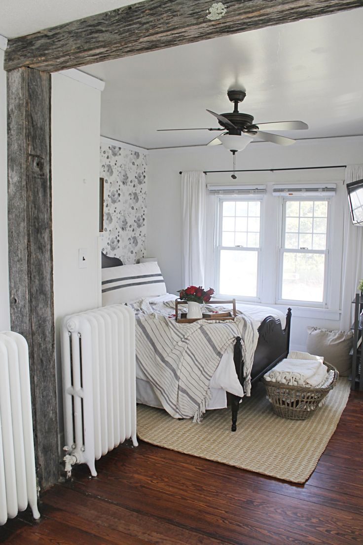 Farmhouse Master Bedroom complete with barn beam.