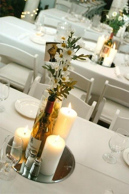 Wine bottle centerpieces wedding centerpieces pinterest for Wine bottle table centerpieces