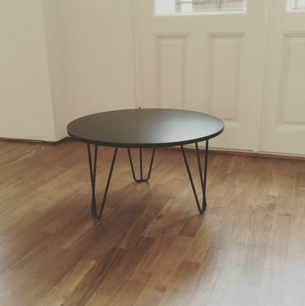 Black round coffee table.
