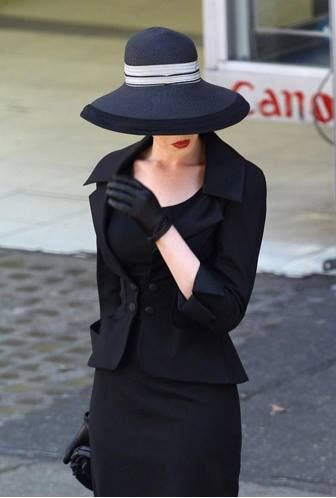 Dior - I think this is a pic of Anne Hathaway. I remember this suit from a photo shoot just before TDKR