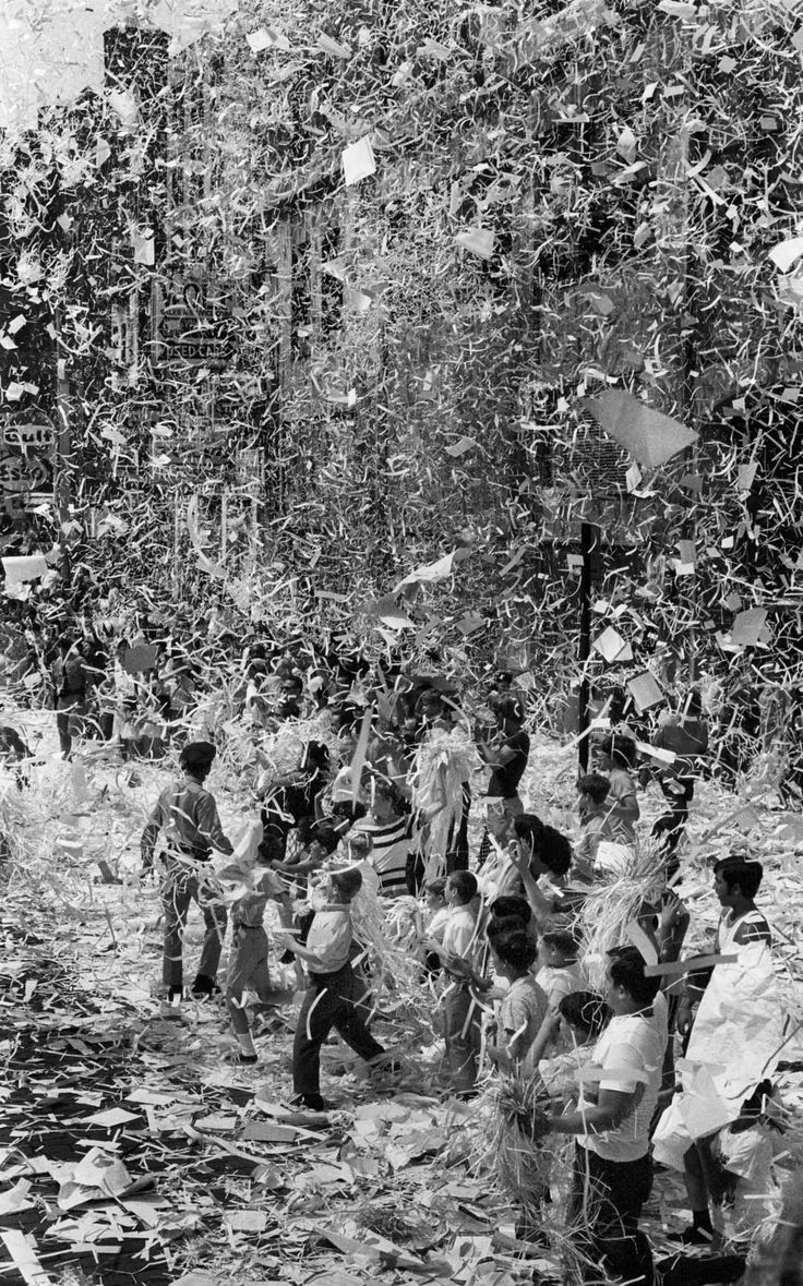 A ticker-tape shower for Neil Armstrong, Buzz Aldrin, and Mike Collins after their return from the moon, 1969.